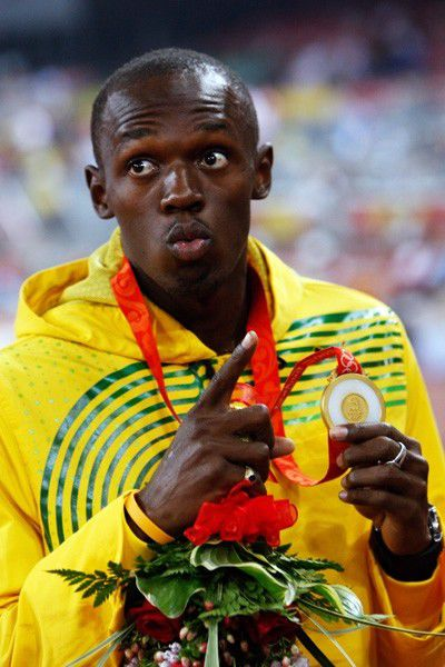 Usain Bolt with his Olympic 100m gold medal